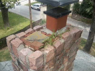 Beautiful heavy stone was added to this existing chimney. The extra weight caused the fireplace to pull away from the exterior wall. They had no clue how to install a proper chimney crown...thus the grass growing on top.