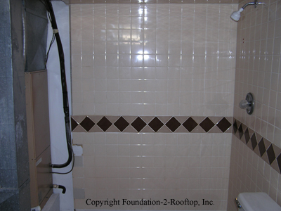 Electrocution hazard with this shower using the 120 amp electric furnace as part of its surround.