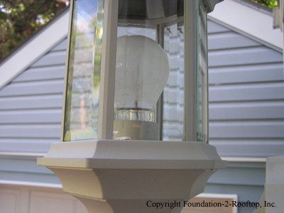 Exterior light installed upside down and holding water.