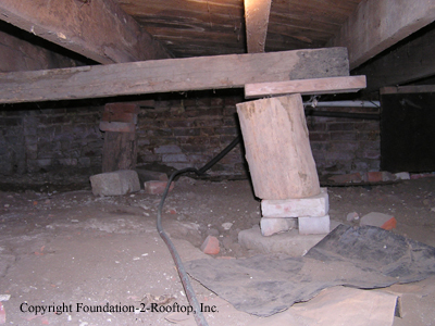 Firewood supporting the floor joists.