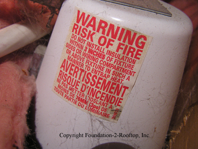 Warning label on the uninsulated canned light.