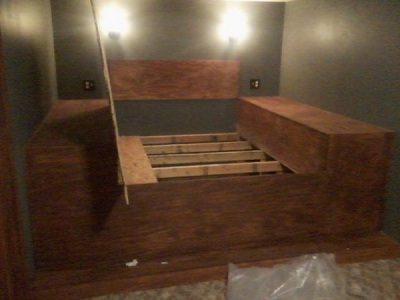 This bed looked great. Buyer sees it as a bedroom that they don't have to buy a bed for. Unbelievable, the extreme the owner went through to cover this grate up.