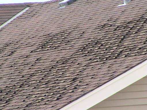 Roof Inspection: Fishmouthing of Organic Backed Shingles