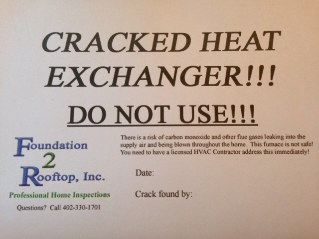 Cracked Heat Exchanger sticker we install on furnaces when we condemn them.